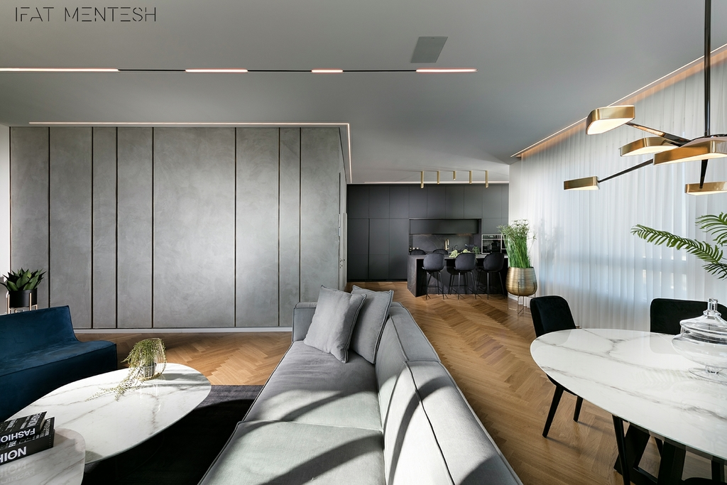 שילוב ועיצוב גופי תאורה מגוונים בסגנון מודרני אקלקטי, בעוצמות אור שונות, למראה אלגנטי ייחודי. (אלעד גונן)