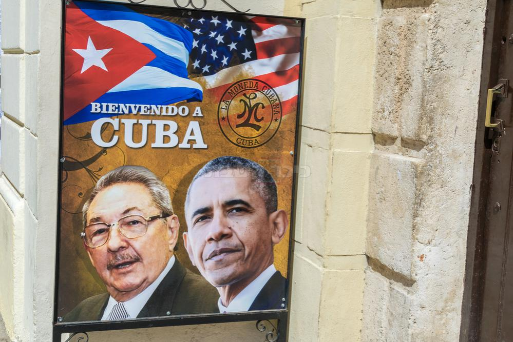 שילוט שנתלה ברחובות קובה עם חימום היחסים בתקופת אובמה (צילום: Shutterstock)