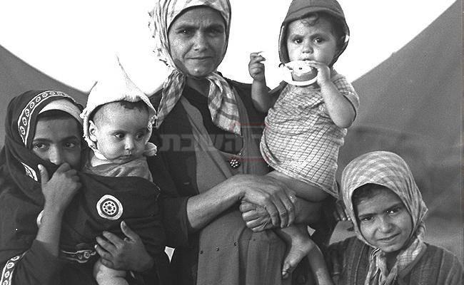 משפחה בעת הגיעה מתימן לישראל. אילוסטרציה (צילום: דוד אלדן, לע''מ)