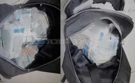 התיק עם הכסף שנשדד (צילום: דוברות המשטרה)