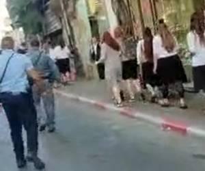 תיעוד רועש: נטורי קרתא שאגו על בנות המצעד; השוטרים הגנו עליהן