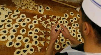 (צילום: פלאש 90) - אוזני המן: תמרים, צימוקים, אגוזים