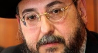 הרב אמסלם. מרוצה (צילום: פלאש 90)