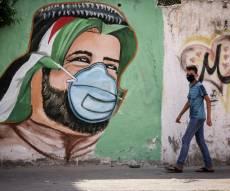 ה'קורונה' בעזה: ציורי קיר לעידוד המסכות