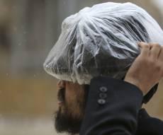 שבוע גשום? הגיע הזמן להחליף את הדרכון. אילוסטרציה - שבוע גשום? הרווחת חידוש דרכון בתעריף מוזל