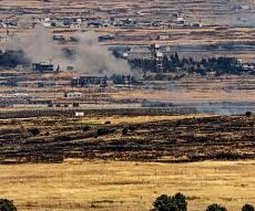 עשן מהקרבות בגולן הסורי. ארכיון - המורדים הסורים לקראת עזיבת הגולן?
