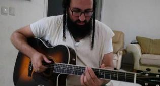 אסרף והגיטרה שהושבה