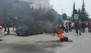 מול הכנסת: סוחרים הפגינו; והבעירו צמיגים