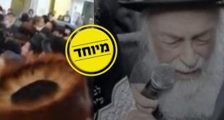ניצול השואה עם ספר התורה בידו