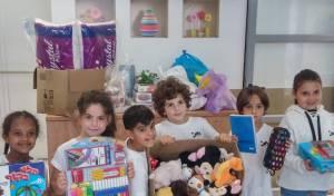 ילדי כיתה א' אספו צעצועים למשפ' גינזבורג