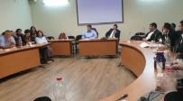 גרינברג בישיבה עם המנהלים