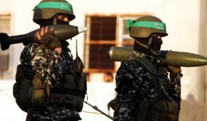 """פעילים בזרוע הצבאית של חמאס. ארכיון - הקבינט: """"אין מו""""מ בלי פירוק חמאס מנשקו"""""""