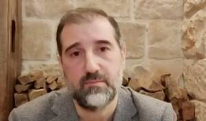 סוער בסוריה: בן דודו של הנשיא אסד מתחנן
