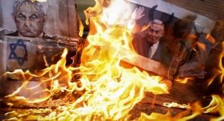 ביקור נתניהו בחברון: פלסטינים שרפו את תמונתו