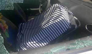 אילוסטרציה - האם הצילה את בתה; חולצה מרכב נעול