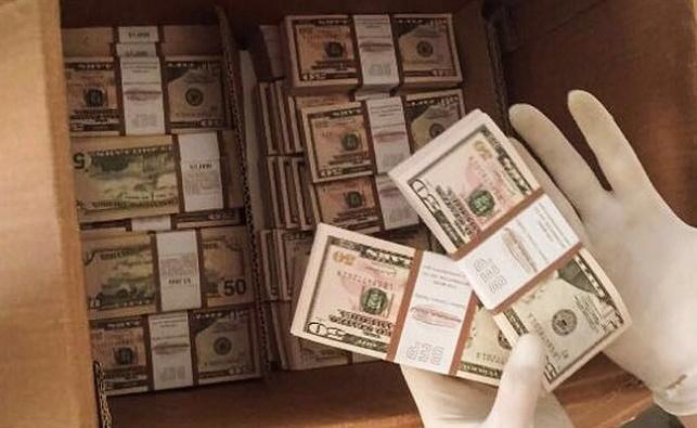 600 אלף דולרים מזויפים נתפסו בדירה בחולון