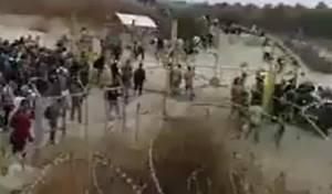 צפו: מאות פלסטינים פורצים לשטח ישראל