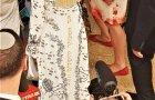 לא, זו לא פרוכת - זו פרוכת או השמלה שלבשה אשת הטייקון?