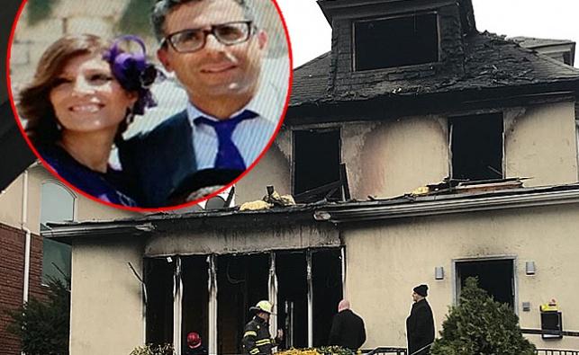 """יוסי ורעייתו ע""""ה על רקע הבית השרוף"""