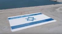 נמל המפרץ התחדש בדגל ענק ומרהיב • צפו