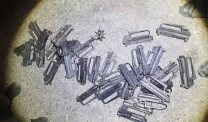 חלק מחלקי הנשקים שנמצאו