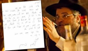 הרב פינסון לצד מכתב ההתנצלות