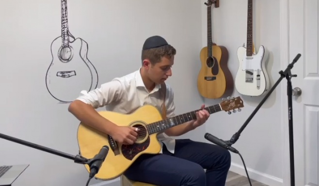 עילוי הגיטרה הצעיר מדהים עם 'ניגון אלול'