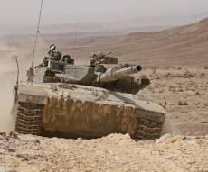 """אילוסטרציה, ארכיון - עמדה צבאית הוצתה; טנק צה""""ל תקף בעזה"""