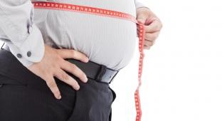 מד משקל. ksp. אילוסטרציה - לא בטוחים כמה אחוזי שומן הצטברו בחגים?