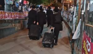 בשעות הלילה: המונים מגיעים לעיירה אומן