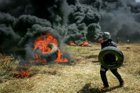 צמיגים בוערים בגבול עזה - גולשים ערבים תומכים בישראל, נגד החמאס