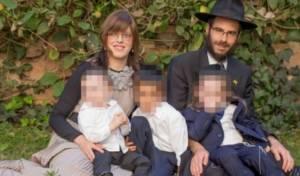 הרב נוטיק ורעייתו עם הילדים