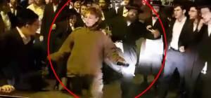 יריקות ובעיטות: מפגינים תקפו חיילת • צפו