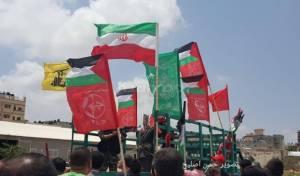 דגלי חמאס בתהלוכה בעזה - קטאר החלה לגרש את בכירי חמאס משטחה