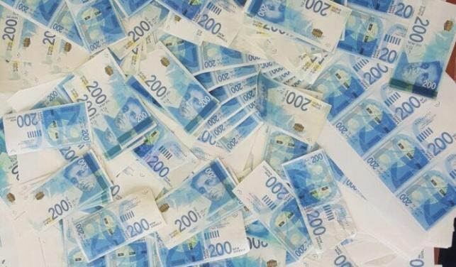 נתפסו מאות אלפי שקלים בשטרות מזויפים