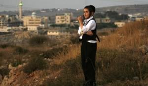 ילד מביתר על רקע הכפר חוסאן. אילוסטרציה, למצולם אין קשר לידיעה