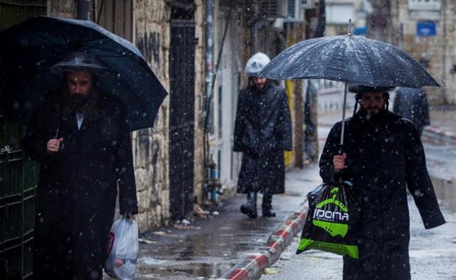 הסערה חוזרת מחר: גשם, אובך ושלג בגולן