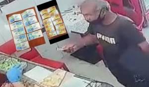 החשוד משלם לכאורה בכסף מזויף