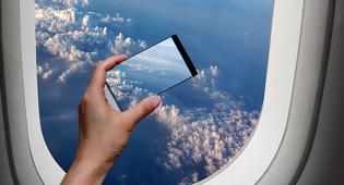 אילוסטרציה - חדש: ניתן להשתמש בטלפון בטיסה