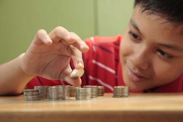 באיזה גיל לספר על הילדים על כסף?