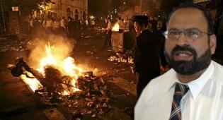 שמואל יצחקי על רקע המהומות (פלאש 90)