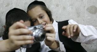 שקט, מצלמים. אילוסטרציה: פלאש 90 - ישראל ברדוגו עושה בית ספר לצלמים
