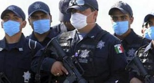 ממקסיקו לאסיה. חיילים מקסיקניים חבושי מסכות הגנה - שפעת מקסיקו מתפשטת באסיה