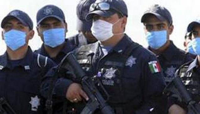 ממקסיקו לאסיה. חיילים מקסיקניים חבושי מסכות הגנה